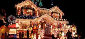 One House of Many Lit Up for Christmas on Candy Cane Lane